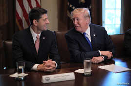 U.S. President Donald Trump talks with House Speaker Paul Ryan (R-WI) as he promotes a newly unveiled Republican tax plan with House Republican leaders in the Cabinet Room of the White House in Washington, Nov. 2, 2017.