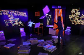 "A pizza box playroom created with neon lights and colorful fluorescent tape called ""Gazoo,"" is part of a group art exhibition celebrating pizza at The Museum of Pizza in New York, Nov. 2, 2018."