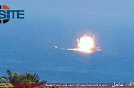 Photo posted on SITE intelligence group website appears to show an Egyptian frigate being hit by a rocket that Islamic State says it fired, July 16, 2015. (SITE)