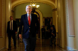 U.S. Senate Majority Leader Mitch McConnell (R-KY) leaves the Senate floor during debate over the Republican tax reform plan in Washington, Dec. 2, 2017.