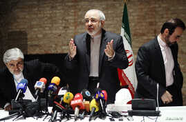 FILE - Iranian Foreign Minister Mohammad Javad Zarif (C) and diplomats leave a news conference in Vienna.