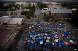 "A large homeless encampment is formed on the ""Plaza of the Flags"" elevated park at the Santa Ana Civic Center complex, Oct. 11, 2017, in Santa Ana, California."