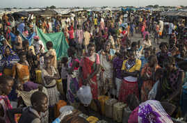 FILE - People wait to fill up water containers in Bentui, South Sudan, July 2, 2014.
