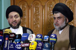 Iraqi Shiite Muslim leader and head of Hikma party Ammar al-Hakim (L) and Shiite cleric Moqtada Sadr speak to the media during a meeting in the Iraqi holy city of Najaf on May 17, 2018.