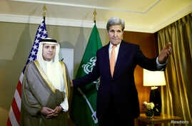 U.S. Secretary of State John Kerry (R) gestures next to Saudi Foreign Minister Adel al-Jubeir during a meeting on Syria in Geneva, Switzerland, May 2, 2016.