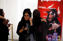 Saudi women attend the opening of a cinema at Riyadh Park mall, in Riyadh, Saudi Arabia April 30, 2018.  According to U-Habitat executive director Maimunah Mohd Sharif says cities need to more liveable for women to succeed if they are home, as expect