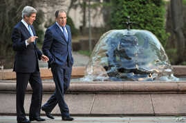 Russian Foreign Minister Sergey Lavrov, right, and U.S. Secretary of State John Kerry walk prior to their talks in Moscow, Russia, May 7, 2013.