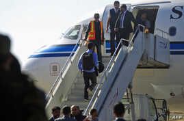 A Yemeni rebel delegation prepares to fly on a Kuwaiti plane accompanied by a UN peace envoy, heading for talks in Sweden with the government aimed at ending the country's devastating war, Dec. 4, 2018 in Sanaa.