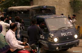 Pakistani police drive men accused of child abuse to the Lahore High Court in Pakistan, August 11, 2015.