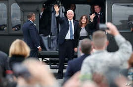 U.S. Vice President Mike Pence and his wife Karen wave before they board on the Air Force Two at Yokota U.S. Air Force Base in Fussa, on the outskirts of Tokyo Tuesday, Nov. 13, 2018.
