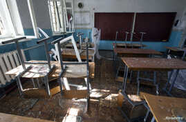 A view of a classroom of school No. 57 damaged by recent shelling in Donetsk, eastern Ukraine, Oct. 1, 2014.