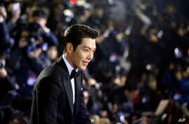 FILE - In this Friday, Nov. 21, 2014 file photo, South Korean actor Kim Woo-bin arrives for a photo call during the Daejong Film Awards in Seoul, South Korea. Chinese anger at South Korea over its decision to deploy an U.S. anti-missile defense syste