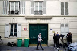 A Tuesday, Oct. 3, 2017 file photo showing the entrance of an apartment building where police found an explosive device. Three men have been handed preliminary terror-linked charges in the failed attack at a residential building in an upscale Paris n