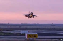 In this video image released by the Egyptian Defense Ministry, an Egyptian fighter jet lands in Egypt, Monday, Feb. 16, 2015.