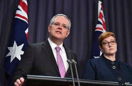 Australian Prime Minister Scott Morrison, left, speaks to the media alongside Foreign Minister Marise Payne during a press conference at the Parliament House in Canberra, Oct. 16, 2018.