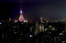 The Ryugyong Hotel is illuminated in the night sky in Pyongyang, North Korea, Sept. 6, 2018, days before the 70th anniversary of the founding of North Korea.