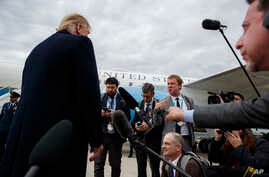 President Donald Trump listens to a question about the missing Saudi journalist Jamal Khashoggi after landing at Cincinnati Municipal Lunken Airport, Oct. 12, 2018, in Cincinnati, Ohio