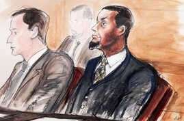 FILE - Tairod Nathan Webster Pugh (r) sits at the defense table with his attorney Zachary S. Taylor, during jury selection in a federal court in the Brooklyn borough of New York, Feb. 24, 2016.