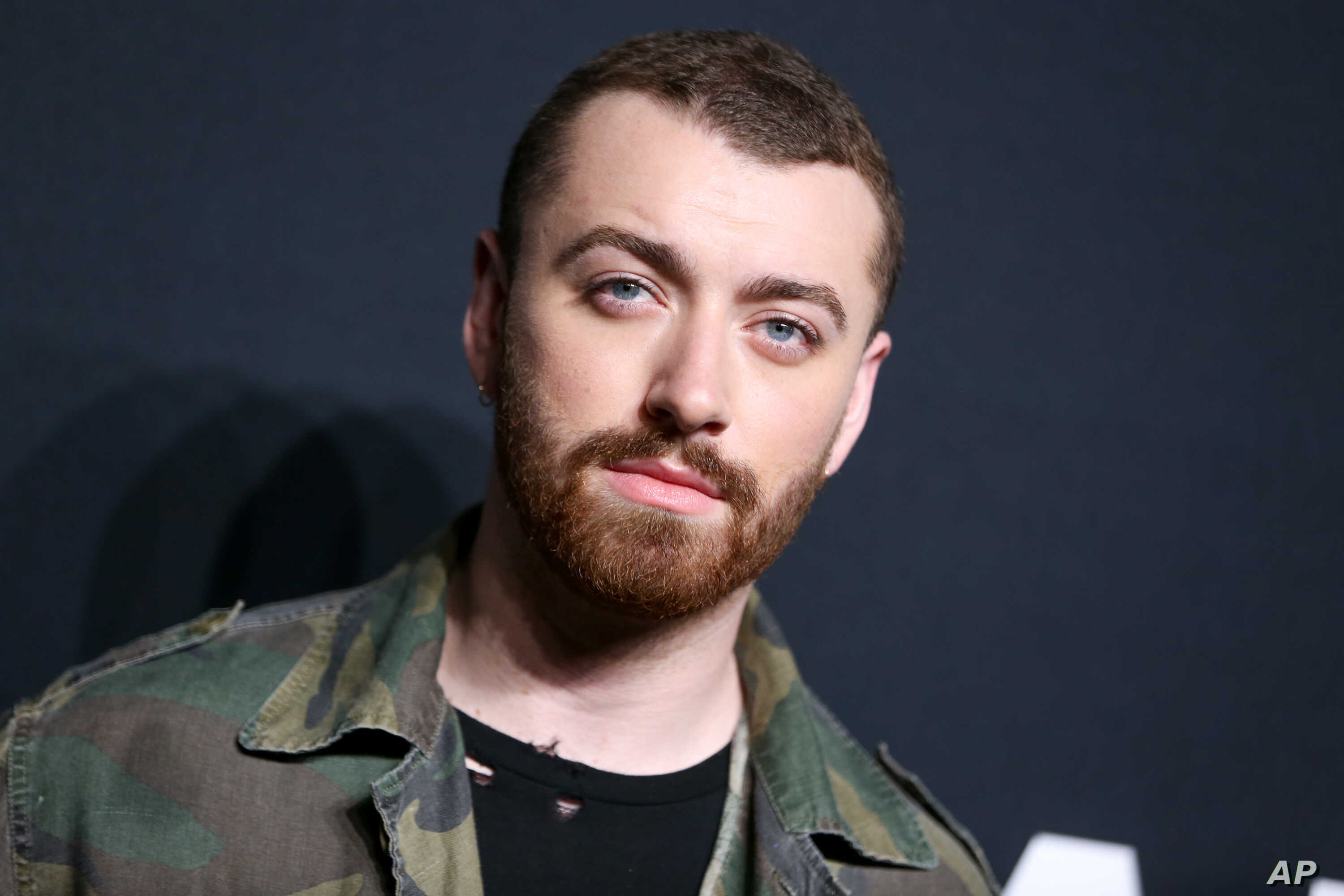 FILE - Sam Smith arrives at Saint Laurent at the Palladium at the Hollywood Palladium in Los Angeles.