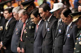 South Korea's Prime Minister Hwang Kyo-ahn, center, pays a silent tribute during a commemorative ceremony marking the 63rd anniversary of the Armistice Agreement and UN Forces Participation in the Korean War in Seoul, South Korea on July 27, 2016.
