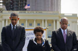 President Barack Obama, Attorney General Loretta Lynch, and Homeland Security Secretary Jeh Johnson stand for a moment of silence at the 34th Annual National Peace Officers Memorial Service, on the West Front of the Capitol in Washington, May 15, 201