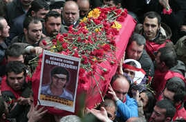 People carry the coffin of Berkin Elvan, a Turkish teenager who was in a coma since being hit on the head by a tear gas canister fired by police during  anti-government protests in the summer of 2013, during his funeral in Istanbul, Turkey, March 12,