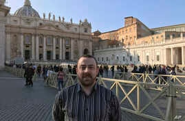 Vincent Doyle, of advocacy group Coping International, poses for a photo during an interview with The Associated Press, in St. Peter's Square at the Vatican, Feb. 20, 2019.
