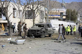 Afghan security forces inspect the site of a suicide attack in Kabul, Afghanistan, Nov. 16, 2014.