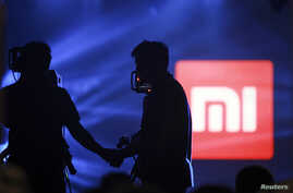 Logo of Xiaomi seen at Xiaomi's tablet launch event, Beijing, May 15, 2014.