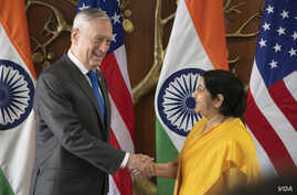 Indian Minister of External Affairs Sushma Swaraj shakes hands with U.S. Defense Secretary James N. Mattis before the start of the 2+2 meeting with U.S. Secretary of State Mike Pompeo and Indian Minister of Defense Nirmala Sitharaman at the Ministry