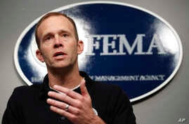 FILE - Federal Emergency Management Agency Administrator Brock Long speaks during a news conference in Washington, Aug. 31, 2017. At FEMA headquarters, top officials responsible for responding to large-scale public emergencies meet regularly to condu