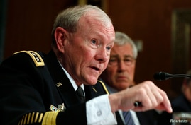 Chairman of the Joint Chiefs Gen. Martin Dempsey speaks next to U.S. Secretary of Defense Chuck Hagel during the defense subcommittee of the Senate Appropriations Committee on Capitol Hill in Washington, June 18, 2014.