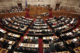 Greece's lawmakers attend a parliament session before a vote for an omnibus reforms bill in Athens, March 30, 2014.
