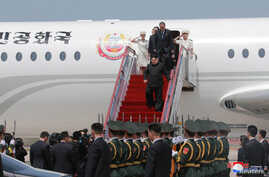 North Korean leader Kim Jong Un walks down from his airplane as he arrives for a visit in Dalian, China in this undated photo released on May 9, 2018 by North Korea's Korean Central News Agency (KCNA).