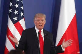 U.S. President Donald Trump gestures while answering a question during a joint press conference with Poland's President Andrzej Duda, in Warsaw, Poland,  July 6, 2017.