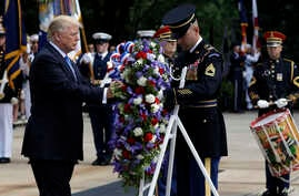 President Donald Trump participates in a wreath laying ceremony at Arlington National Cemetery, May 29, 2017, in Arlington, Va.