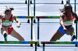 Puerto Rico's Jasmine Camacho-Quinn, right, and Belarus' Alina Talay compete in a women's 100-meter heat during the athletics competitions of the 2016 Summer Olympics at the Olympic stadium in Rio de Janeiro, Brazil, Tuesday, Aug. 16, 2016.