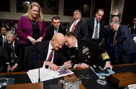 "Director of National Intelligence James Clapper, left, talks with National Security Agency and Cyber Command chief Adm. Michael Rogers on Capitol Hill in Washington, Jan. 5, 2017, at the conclusion of a Senate Armed Services Committee hearing: ""Forei"
