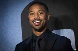 Actor Michael B. Jordan poses for photographers upon arrival at the premiere of the film 'Creed II', in London, Nov. 28, 2018.