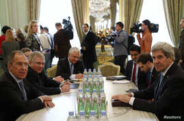 U.S. Secretary of State John Kerry (front R) and Russian Foreign Minister Sergei Lavrov (front L) meet at the Russian ambassador's residence in Paris, March 5, 2014.
