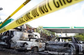 A gas station is seen burned down after disturbances following the police shooting of a man in Milwaukee, Wisconsin, Aug. 14, 2016.