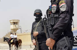 Egyptian policemen secure Egypt's national police academy, where an Egyptian criminal court sentenced ousted Islamist President Mohammed Morsi and 12 Brotherhood leaders and Islamist supporters to 20 years in prison over the killing of protesters in