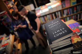 """FILE PHOTO: Copies of former FBI director James Comey's book """"A Higher Loyalty"""" are seen at Kramerbooks book store in Washington D.C., April 17, 2018."""