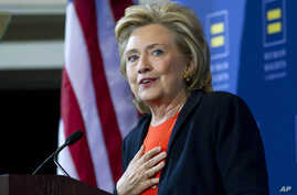 Democratic presidential candidate Hillary Rodham Clinton gestures as she speaks at Human Rights Campaign gathering in Washington, Oct. 3, 2015.