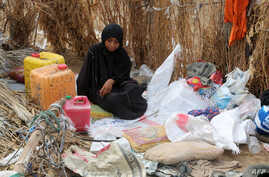 FILE - A Yemeni woman sits in the remains of a home in a neighborhood ravaged by Tropical Cyclone Sagar, in the port city of Hodeidah, Yemen, May 19, 2018