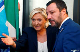 FILE - French far-right leader Marine Le Pen and Italy's far-right leader and interior minister, Matteo Salvini, arrive to hold a news conference in Rome, Oct. 8, 2018.