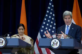 Secretary of State John Kerry, joined by Indian External Affairs Minister Sushma Swaraj, speaks to reporters at the State Department in Washington, Sept. 22, 2015.