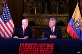 U.S. Vice President Mike Pence, left, and Ecuador's President Lenin Moreno exchange looks during the delivery of a final statement at the government palace in Quito, Ecuador, June 28, 2018.