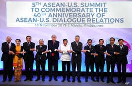 Leaders from left to right, Malaysia's Prime Minister Najib Razak, Myanmar's State Councellor and Foreign Minister Aung San Suu Kyi, Thailand's Prime Minister Prayut Chan-ocha, Vietnam's Prime Minister Nguyen Xuan Phuc, U.S. President Donald Trump, P...