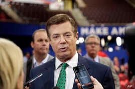 FILE - Paul Manafort, then chairman of Republican Donald Trump's presidential campaign, talks to reporters on the floor of the Republican National Convention at Quicken Loans Arena in Cleveland, July 17, 2016.